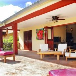 Very spacious porch with lounge seating and pool chairs