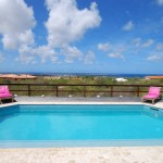 Large swimming pool with comfortable pool chairs